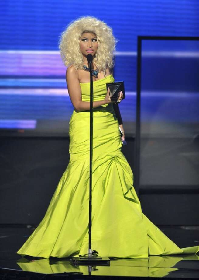 """Nicki Minaj accepts the award for favorite album - rap/hip-hop """"Pink Friday: Roman Reloaded"""" at the 40th Annual American Music Awards on Sunday, Nov. 18, 2012, in Los Angeles. (Photo by John Shearer/Invision/AP)"""