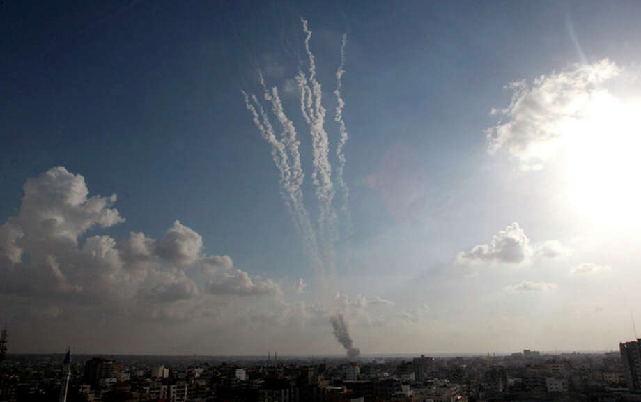 Smoke trails are seen after ordnance were fired by Palestinian militants from Gaza City towards southern Israel, Monday, Nov. 19, 2012. (AP Photo/Hatem Moussa) / AP