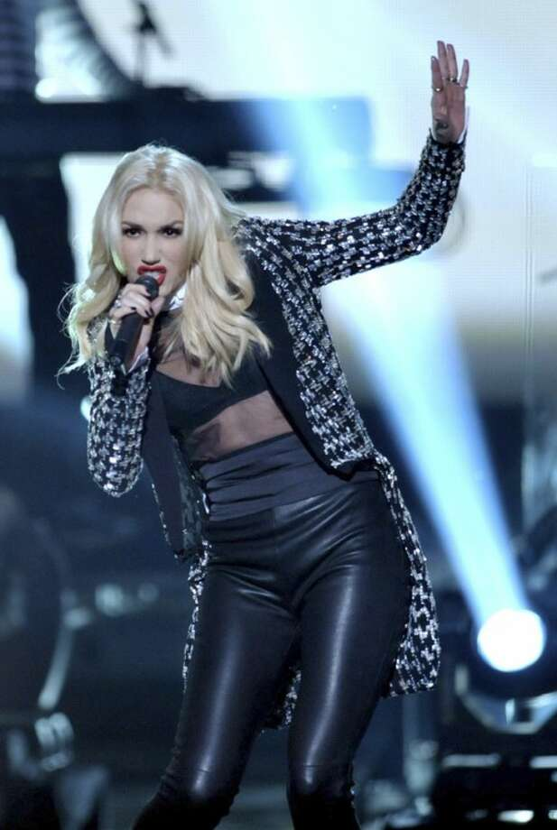 """Gwen Stefani of No Doubt performs """"Looking Hot"""" at the 40th Annual American Music Awards on Sunday, Nov. 18, 2012, in Los Angeles. (Photo by John Shearer/Invision/AP)"""