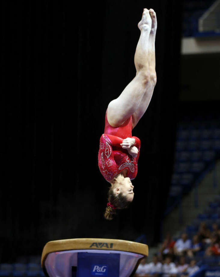McKayla Maroney competes on the vault during the U.S. women's national gymnastics championships in Hartford, Conn., Saturday, Aug. 17, 2013. (AP Photo/Elise Amendola)