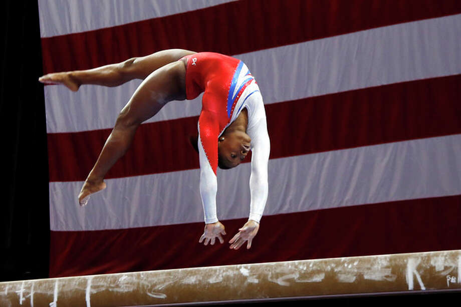 Simone Biles competes on the balance beam during the U.S. women's national gymnastics championships in Hartford, Conn., Saturday, Aug. 17, 2013. (AP Photo/Elise Amendola) / AP