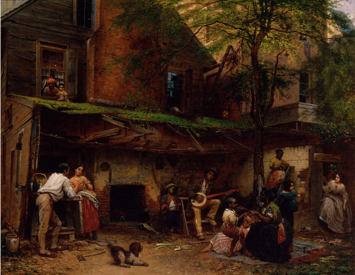 """This undated handout image provided by the Smithsonian American Art Museum Eastman Johnson's 1859 oil on linen, """"Negro Life at the South,"""" part of a major exhibition on how artists represented the war and how the war changed art. It's on view in Washington through April and then moves to New York's Metropolitan Museum of Art. (AP Photo/Smithsonian American Art Museum)"""