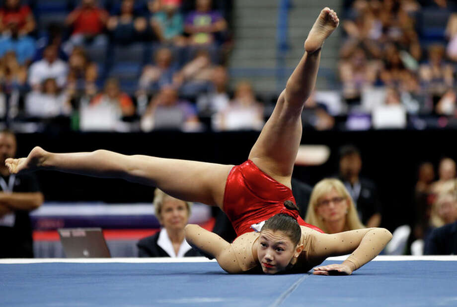 Kyla Ross competes on the floor exercise during the U.S. women's national gymnastics championships in Hartford, Conn., Saturday, Aug. 17, 2013. (AP Photo/Elise Amendola) / AP