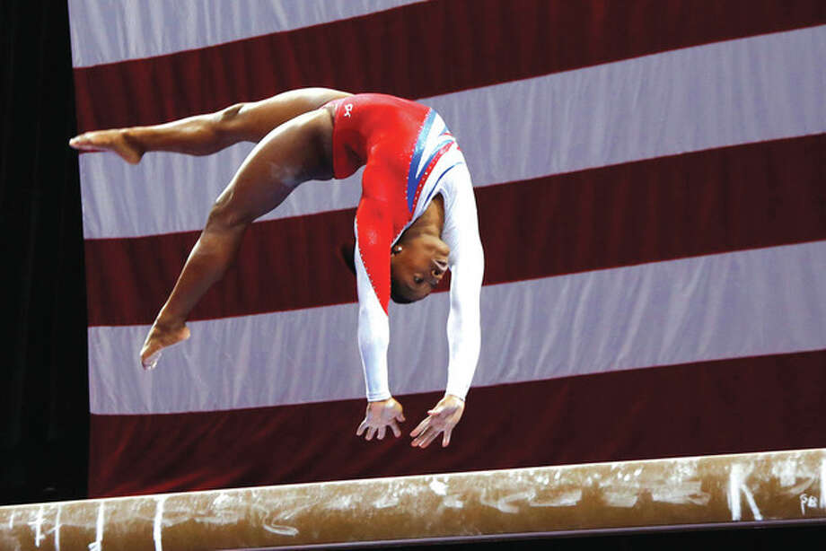 AP photoSimone Biles competes on the balance beam on her way to finishing first at the U.S. women's national gymnastics championships in Hartford Saturday. / AP