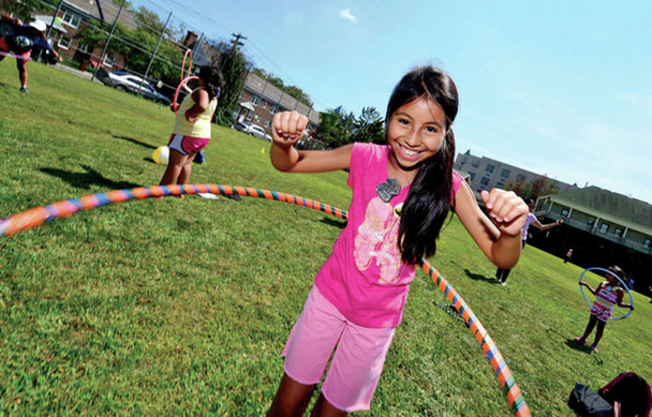 10 year old Jessica Pareja participates in the hula hoop competition during the SoNo Day Out hosted by Norwalk Police Department at Ryan Park Saturday.Hour photo / Erik Trautmann / (C)2013, The Hour Newspapers, all rights reserved