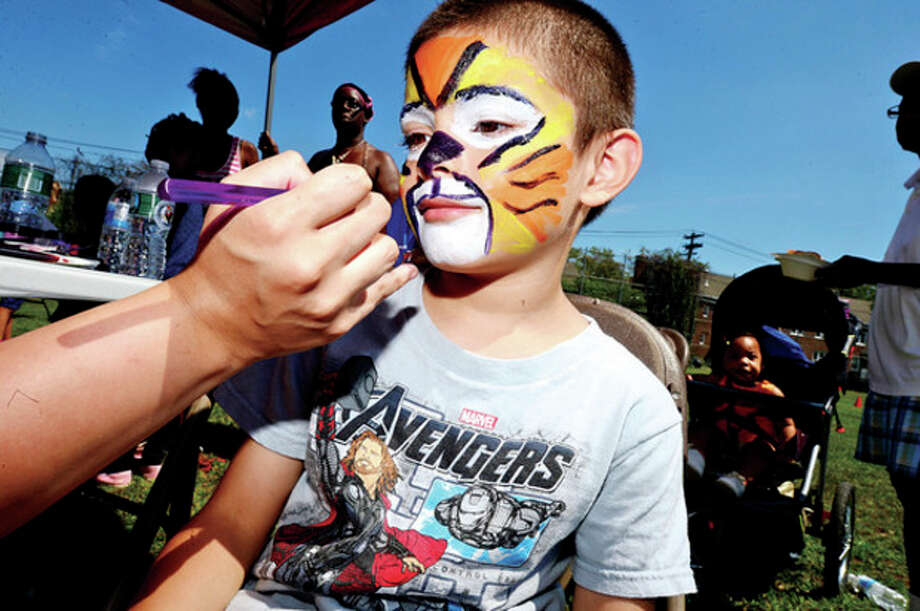 Jeremy Reyes gets his face painted during the SoNo Day Out hosted by Norwalk Police Department at Ryan Park Saturday.Hour photo / Erik Trautmann / (C)2013, The Hour Newspapers, all rights reserved