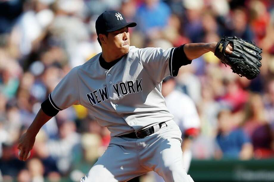 New York Yankees' Hiroki Kuroda pitches in the first inning of a baseball game against the Boston Red Sox in Boston, Saturday, Aug. 17, 2013. (AP Photo/Michael Dwyer) / AP