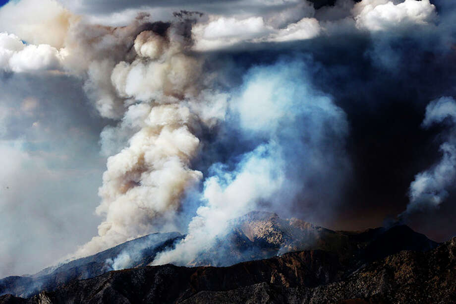 The Patch Springs Fire burns in the Stansbury Mountains of Utah, Friday, Aug. 16, 2013. (AP Photo/ Deseret News, Ravell Call) / DESERET NEWS