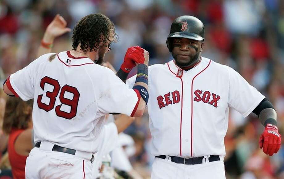 Boston Red Sox's David Ortiz, right, celebrates his solo home run with teammate Jarrod Saltalamacchia (39) in the seventh inning of a baseball game against the New York Yankees in Boston, Saturday, Aug. 17, 2013. (AP Photo/Michael Dwyer) / AP