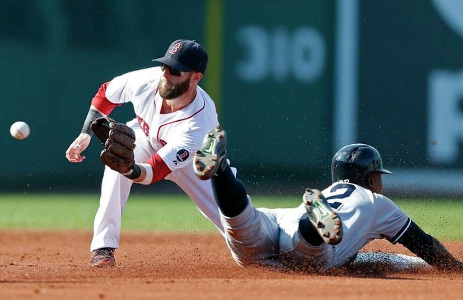 New York Yankees' Alfonso Soriano, right, steals second base as Boston Red Sox's Dustin Pedroia awaits the throw in the second inning of a baseball game in Boston, Saturday, Aug. 17, 2013. (AP Photo/Michael Dwyer) / AP