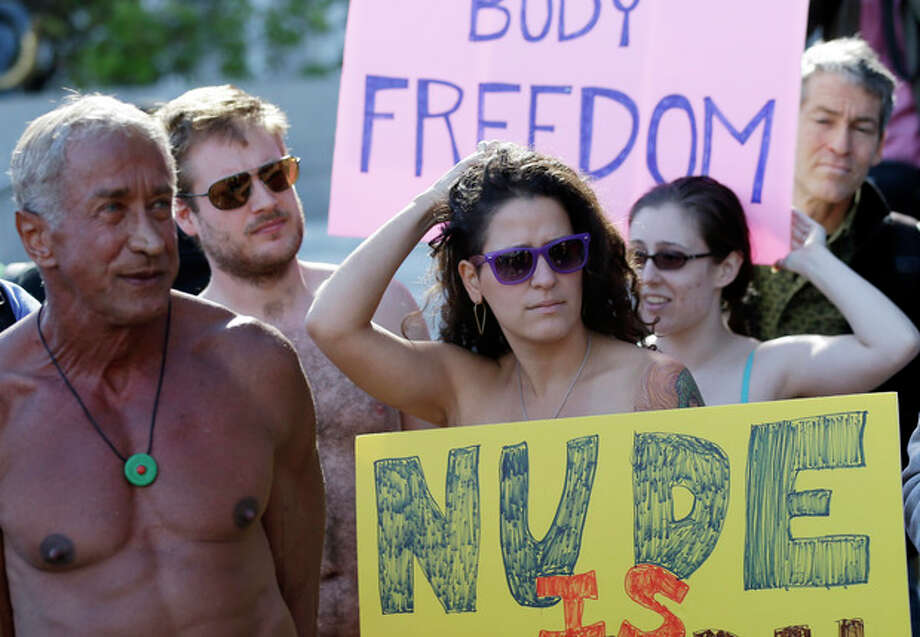 Demonstrators gather outside of City Hall in San Francisco for a protest against a proposed city-wide nudity ban, Wednesday, Nov. 14, 2012. San Francisco appears poised to shed part of its image as a city where anything goes, including clothing. The Board of Supervisors is scheduled to vote next week on a law that would ban public nudity. The proposal comes in response to a devoted group of nudists who proudly strut their stuff through the city's Castro District. (AP Photo/Marcio Jose Sanchez) / AP
