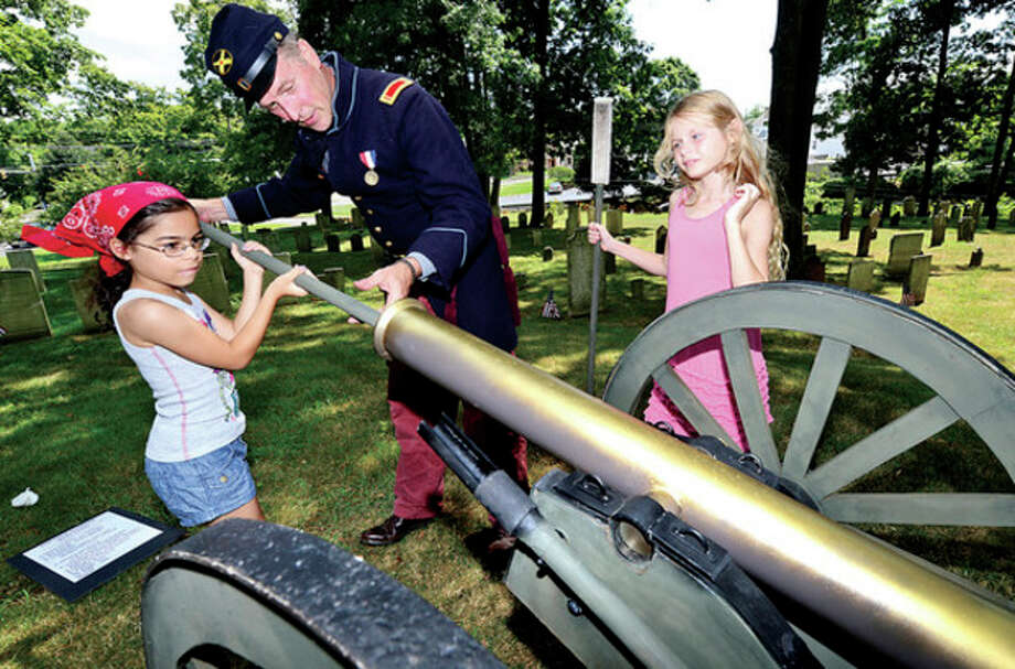 Civil War reenactor Brian Kammerer helps 9 year old Eliana Alonso and 7 year old Nina Meyer-Mitchell load a simulated canon as The Norwalk Historical Society hosts the third annual Civil War BBQ and Encampment at Mill Hill Historic Park Saturday.Hour photo / Erik Trautmann / (C)2013, The Hour Newspapers, all rights reserved
