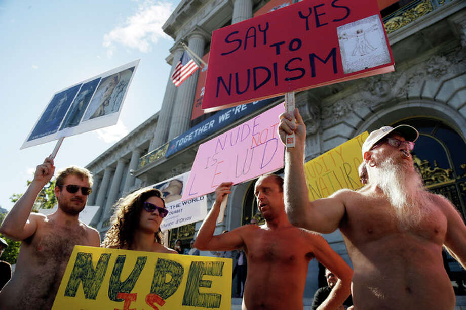 Demonstrators gather at a protest against a proposed nudity ban outside of City Hall in San Francisco, Wednesday, Nov. 14, 2012. San Francisco appears poised to shed part of its image as a city where anything goes, including clothing. The Board of Supervisors is scheduled to vote next week on a law that would ban public nudity. The proposal comes in response to a devoted group of nudists who proudly strut their stuff through the city's Castro District. (AP Photo/Marcio Jose Sanchez) / AP