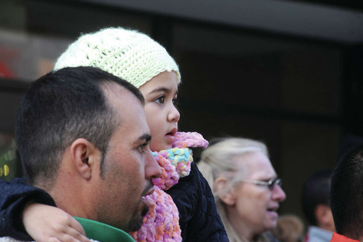 3 year old Camilla Mungui at the 2012 UBS Parade Spectacular heads down Summer street in Stamford on Sunday. hour photo/Matthew Vinci