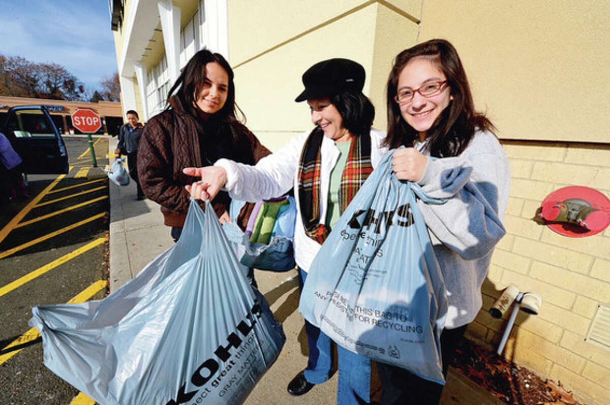 Shoppers including Sonia Rosales, Maria Gaitan and Lindsay Gaitan, flock to area stores like Kohl's on Black Friday to take advantage of sale pricing. Hour photo / Erik Trautmann