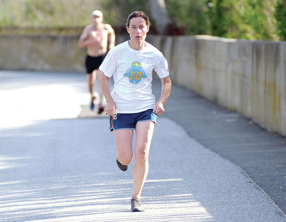 Hour photo/John NashDeirdre O'Farrelly of Westport was the top women's finisher at Saturday morning's Westport Road Runners 8.4 mile race at Burying Hill Beach in Westport. It was O'Farrelly's first-ever win in the series, which she has been running since 2008.