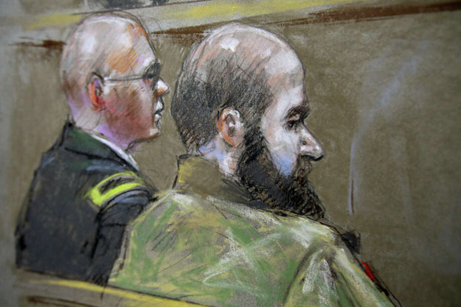 File - In this Aug. 21, 2013 file courtroom sketch, U.S. Army Maj. Nidal Malik Hasan, right, and his defense attorney, Lt. Col. Kris Poppe, are shown during Hasan's court-martial trial in Fort Hood, Texas. Hasan has been convicted of murder for the 2009 shooting rampage at Fort Hood that killed 13 people and wounded more than 30 others. (AP Photo/Brigitte Woosley, File) / FR170958 AP