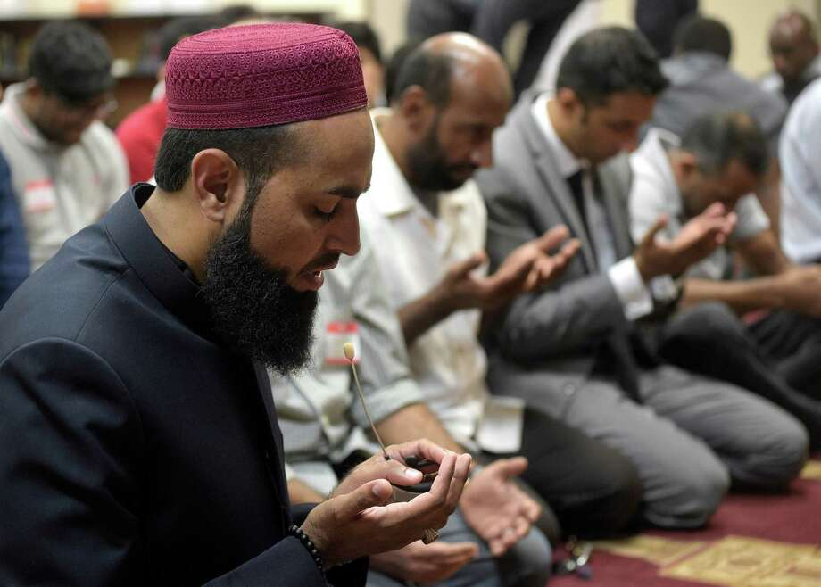 Imam Azhar Subedar, left, speaks during a special prayer with non-Muslim members of the community at the American Muslim Community Center Monday, June 13, 2016, in Longwood, Fla., after the mass-shooting at the Pulse Orlando nightclub. Dozens of people were killed at the gay nightclub in the deadliest shooting in modern U.S. history. (AP Photo/Phelan M. Ebenhack) Photo: Phelan M. Ebenhack, FRE / FR121174 AP