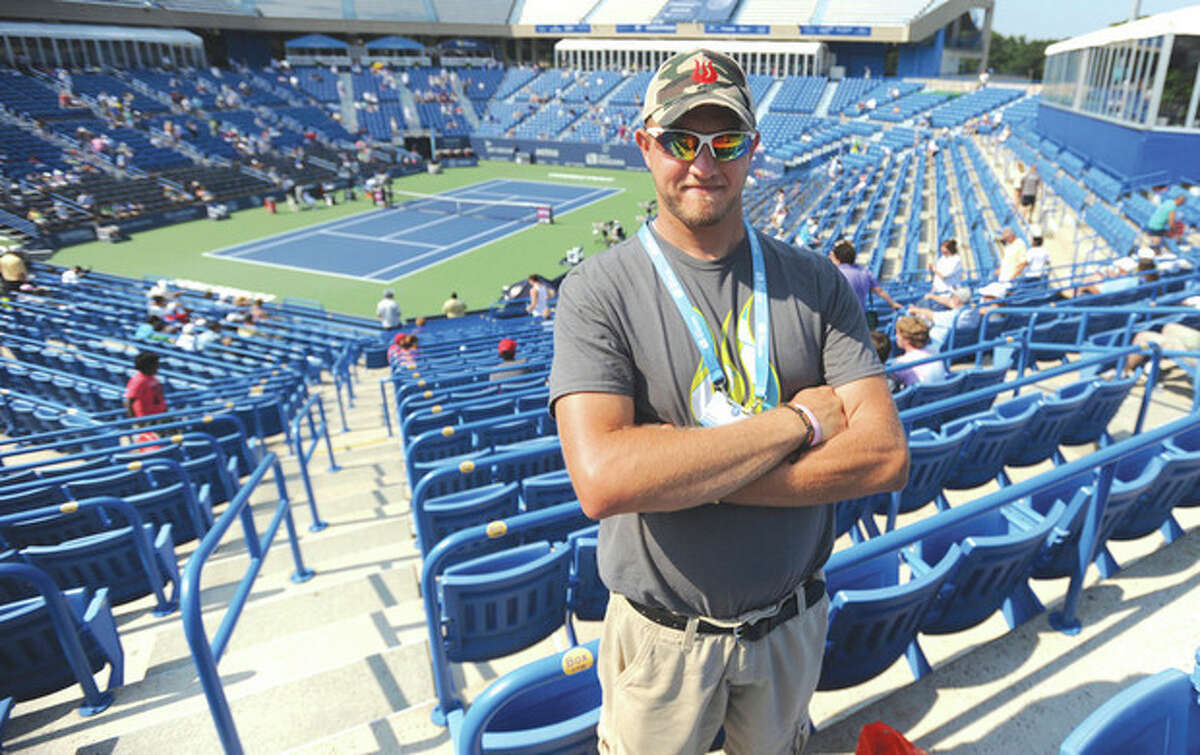 Hour photo/John Nash Dave Csordas of Wilton has been a volunteer at the New Haven Open for eight years. For the last four years, the 23-year-old has served as an usher.
