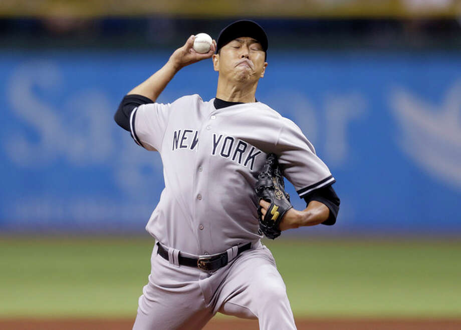 New York Yankees starting pitcher Hiroki Kuroda, of Japan, delivers to Tampa Bay Rays' Ben Zobrist during the first inning of a baseball game on Friday, Aug. 23, 2013, in St. Petersburg, Fla. (AP Photo/Chris O'Meara) / AP