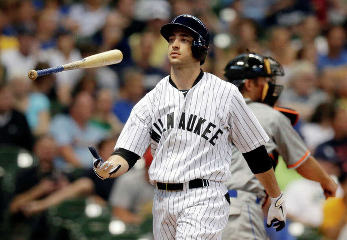 FILE - In this July 20, 2013, file photo, Milwaukee Brewers' Ryan Braun flips his bat after striking out during the third inning of a baseball game against the Miami Marlins in Milwaukee. Braun has finally admitted taking performance-enhancing drugs during his NL MVP season of 2011. The suspended Milwaukee slugger said in a statement released Thursday, Aug. 22, 2013, by the Brewers that he took a cream and a lozenge containing banned substances while rehabilitating an injury. (AP Photo/Morry Gash, File)