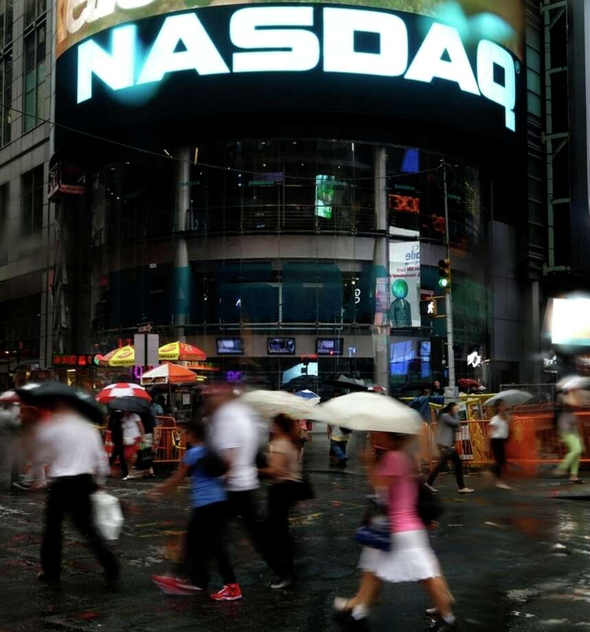 The Nasdaq logo is displayed on its building in New York, Thursday, Aug. 22, 2013. Nasdaq halted trading Thursday because of a technical problem, the latest glitch to affect the stock market. (AP Photo/Seth Wenig) / AP