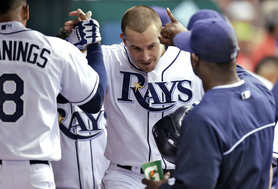 Tampa Bay Rays' Evan Longoria, center, celebrates with teammates after his third-inning home run hit off New York Yankees' pitcher Hiroki Kuroda, of Japan, during a baseball game on Friday, Aug. 23, 2013, in St. Petersburg, Fla. (AP Photo/Chris O'Meara) / AP