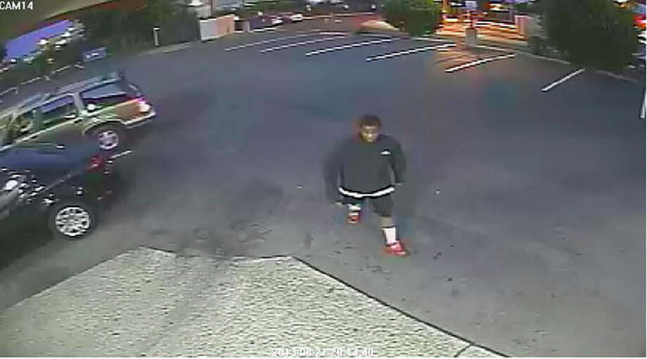 This image from surveillance video provided by the the Spokane, Wash., Police Department shows a person that authorities say is a suspect in the beating death of an 88-year-old World War II veteran outside an Eagles lodge in Spokane, Wednesday, Aug. 21, 2013. Police say they have arrested one of two teens suspected of fatally beating Delbert Belton in his car at random Wednesday night outside the lodge as he was waiting for a friend. Belton was found with serious head injuries and died in the hospital Thursday. (AP Photo/Spokane Police Department) / Spokane Police Department