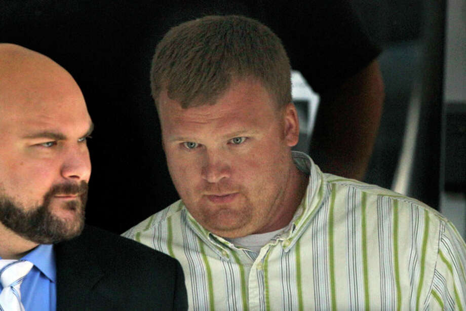 "In this June 20, 2012 file photo, Matt Sandusky, adopted son of Jerry Sandusky, right, leaves the Centre County Courthouse in Bellefonte, Pa. A Philadelphia attorney said Friday Aug. 23, 2013 seven young men he represents have finalized deals with Penn State over claims of abuse by the school's former assistant football coach, Jerry Sandusky. Lawyer Matt Casey said his clients include Sandusky's adopted son, Matt, as well as the young man known as ""Victim 2"" in court records and three other victims who testified last summer against Jerry Sandusky at his criminal trial. (AP Photo/Gene J. Puskar, File) / AP"