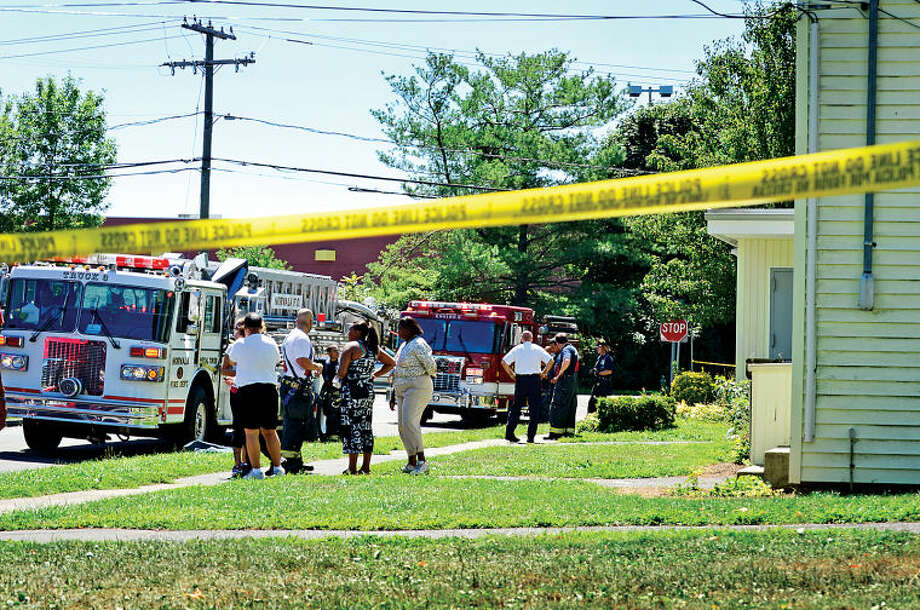 Norwalk Fire Department respond to Colonial Village to the scene of a fire at unit Saturday.Hour photo / Erik Trautmann