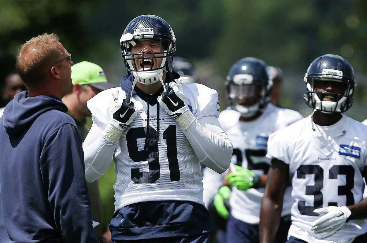 Seahawks defensive end Cassius Marsh talks with coaching staff during the team's minicamp at Virginia Mason Athletic Center in Renton, Wa., Tuesday, June 14, 2016.