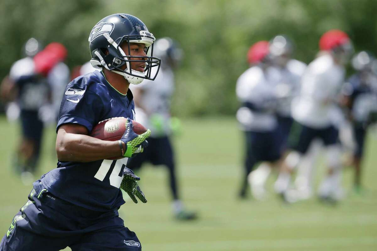 Seahawks Tyler Lockett works on punt returns during the team's minicamp at Virginia Mason Athletic Center in Renton, Wa., Tuesday, June 14, 2016.