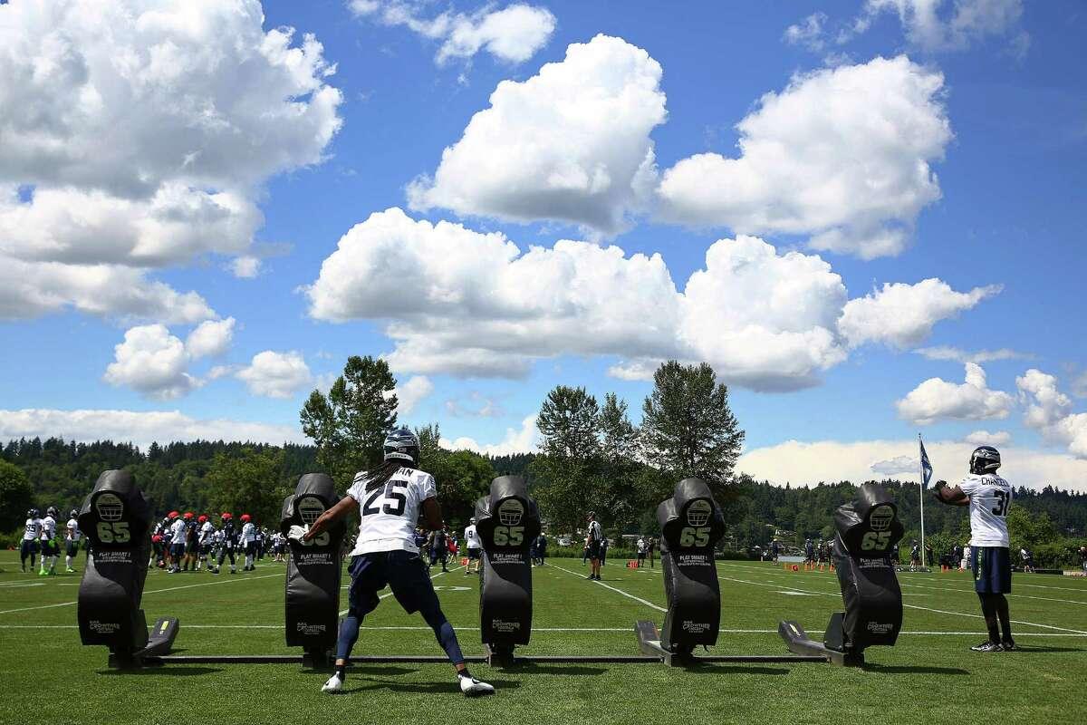 Seahawks cornerback Richard Sherman (25) practices blocks during the team's minicamp at Virginia Mason Athletic Center in Renton, Wa., Tuesday, June 14, 2016.
