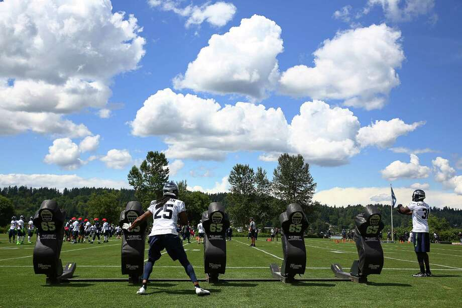 Seahawks cornerback Richard Sherman (25) practices blocks during the team's minicamp at Virginia Mason Athletic Center in Renton, Wa., Tuesday, June 14, 2016. Photo: GENNA MARTIN, SEATTLEPI.COM / SEATTLEPI.COM