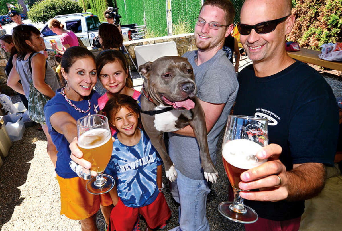 Rudi, Charlie, Zoe and Pete Karukas visit with Winson and volunteer Keelen Freeman during Barks & Beer benefit for Bully Breed Rescue where a $ donation gets you a free beer at the new Farm Terrace Beer Garden at SoNo Market Saturday. Hour photo / Erik Trautmann