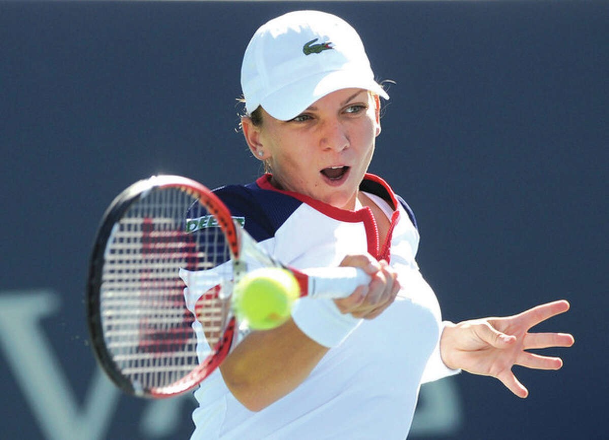 AP photo Simona Halep hits a forehand during her 6-2, 6-2, victory over defending champion Petra Kvitova in the final of the New Haven Open tennis tournament in New Haven.