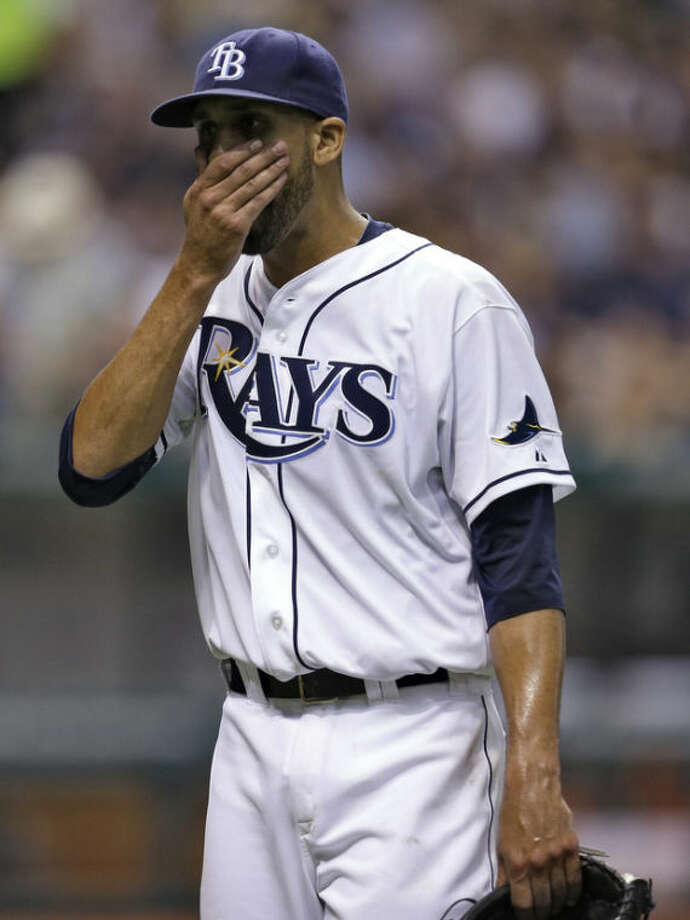 Tampa Bay Rays starting pitcher David Price reacts after giving up two runs to the New York Yankees during the fifth inning of a baseball game on Saturday, Aug. 24, 2013, in St. Petersburg, Fla. (AP Photo/Chris O'Meara)