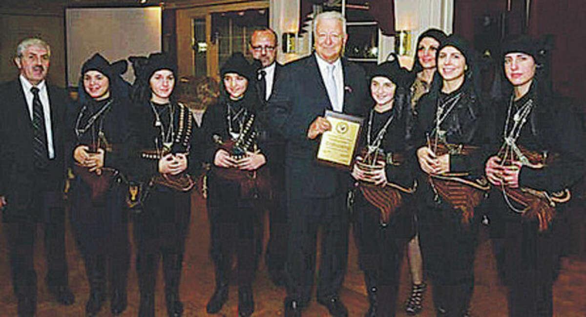 Contributed photo Mayor Richard A. Moccia, at center, stands with George P. Tsilfidis, president, Georgia Kiriakides, Theano Pergantis, Vicky Theodorides, Andrianna Goodchild, Panagiota Tsilfides and Yanna Tarasides on Nov. 17.