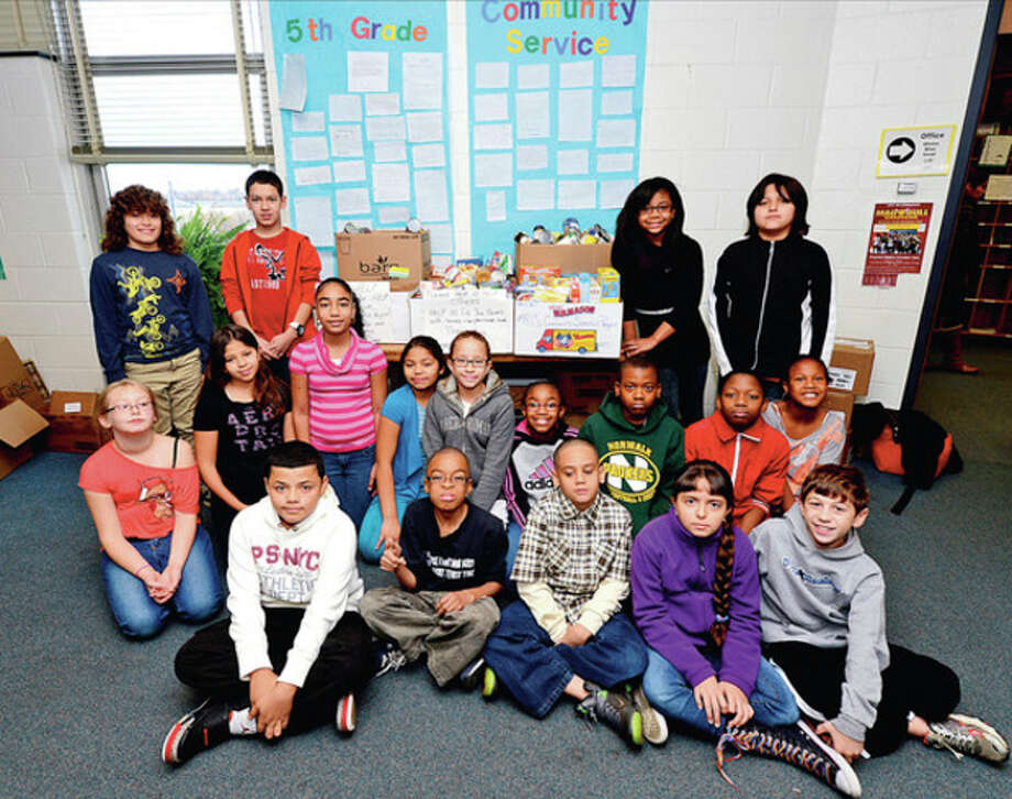 Hour photo / Erik TrautmannJefferson 5th-graders pitch inFifth-grade students from Mrs Lewellyn's class who collected the most food for Christian Community Action as part of the school's entire fifth-graders' lesson on community service. / (C)2012, The Hour Newspapers, all rights reserved