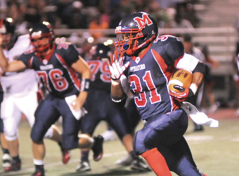 Hour photo/John Nash - Kyle Jordan will lead Brien McMahon into Thursday's Thanksgiving Day showdown with Norwalk.