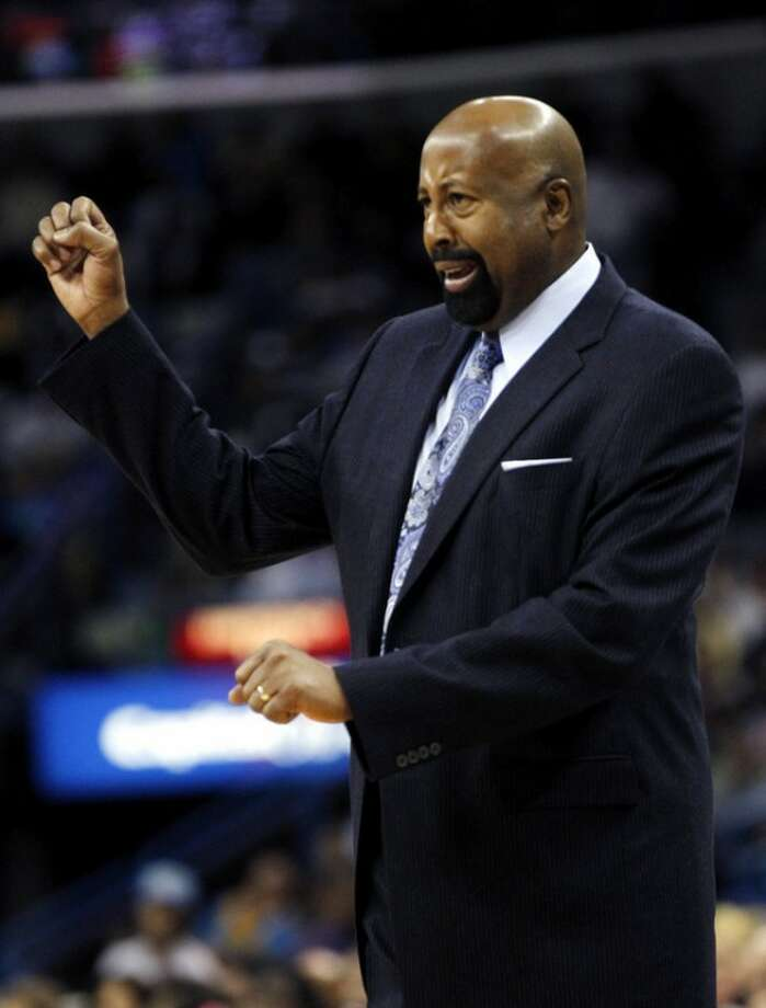 New York Knicks coach Mike Woodson calls out to his team in the first half of an NBA basketball game against the New Orleans Hornets in New Orleans, Tuesday, Nov. 20, 2012. (AP Photo/Gerald Herbert)