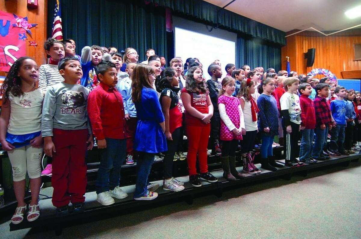 Students sing the Marine Corps Hymn during a program for Veterans at Stark elementary School in Stamford