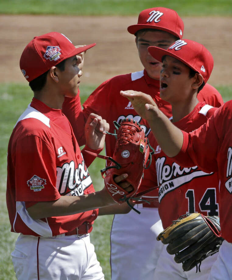 Tijuana, Mexico, pitcher Martin Gonzalez, left, celebrates with teammates, Miguel Artalejo, center, and Brandon Montes (14) after getting the final out of a 15-14 win over Westport, Conn., in a consolation baseball game at the Little League World Series tournament in South Williamsport, Pa., Sunday, Aug, 25, 2013. (AP Photo/Gene J. Puskar)
