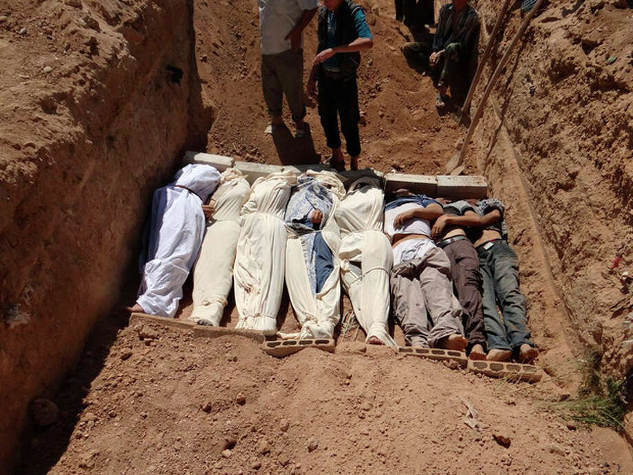 "FILE- This Aug. 21, 2013, file image provided by by Shaam News Network, which has been authenticated based on its contents and other AP reporting, purports to show several bodies being buried during a funeral in a suburb of Damascus, Syria. A senior administration official said Sunday, Aug. 25, 2013, that there is ""very little doubt"" that a chemical weapon was used by the Syrian regime against civilians in an incident that killed at least a hundred people last week, but added that the president had not yet decided how to respond. (AP Photo/Shaam News Network, File) / Shaam News Network"