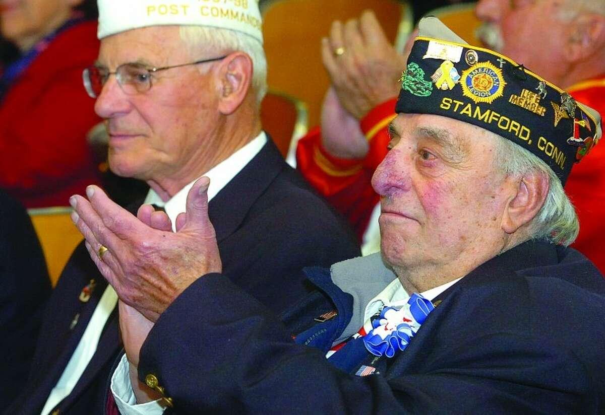 Veterans in the audience applaude the patriotic songs the kids at Stark elementary School sing to honor vets.