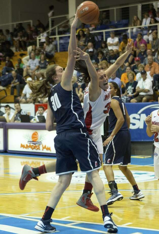 Marist's Kristina Danella, right, reacts as her shot for the basket is blocked by Connecticut's forward Breanna Stewart during the first half of an NCAA women's college basketball game in St. Thomas, U.S. Virgin Islands, Friday, Nov. 23, 2012. (AP Photo/Thomas Layer)