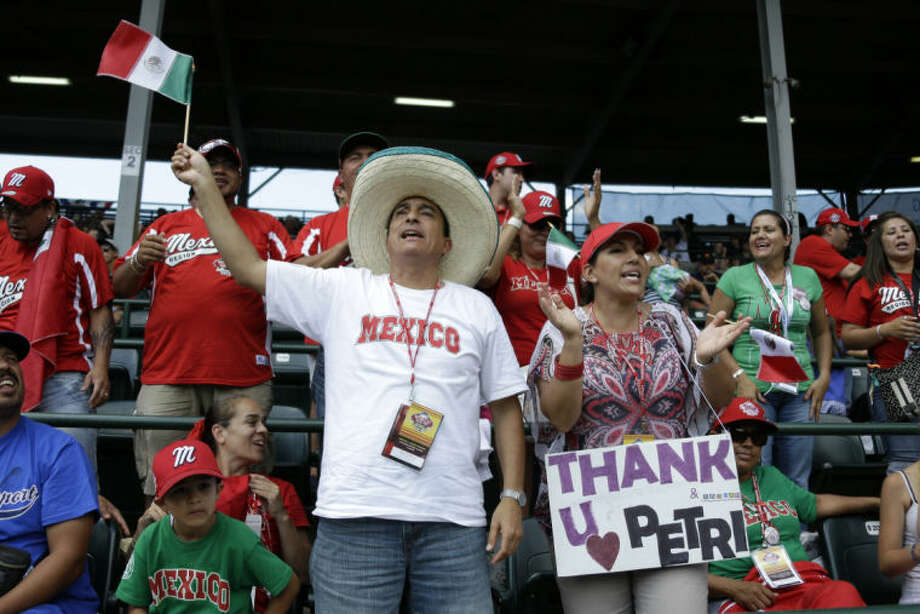Tijuana, Mexico, Little League parents and fans celebrate after the final out of a 15-14 win over Westport, Conn., in a consolation baseball game at the Little League World Series tournament in South Williamsport, Pa., Sunday, Aug, 25, 2013. (AP Photo/Gene J. Puskar)