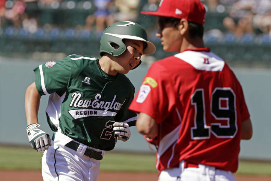 Westport, Conn.'s Chad Knight, left, rounds third past Tijuana, Mexico, third baseman Luis Manzo (19) after hitting a two-run home run off Mexico's, pitcher Miguel Artalejo in the first inning of a consolation baseball game at the Little League World Series tournament in South Williamsport, Pa., Sunday, Aug, 25, 2013. (AP Photo/Gene J. Puskar)