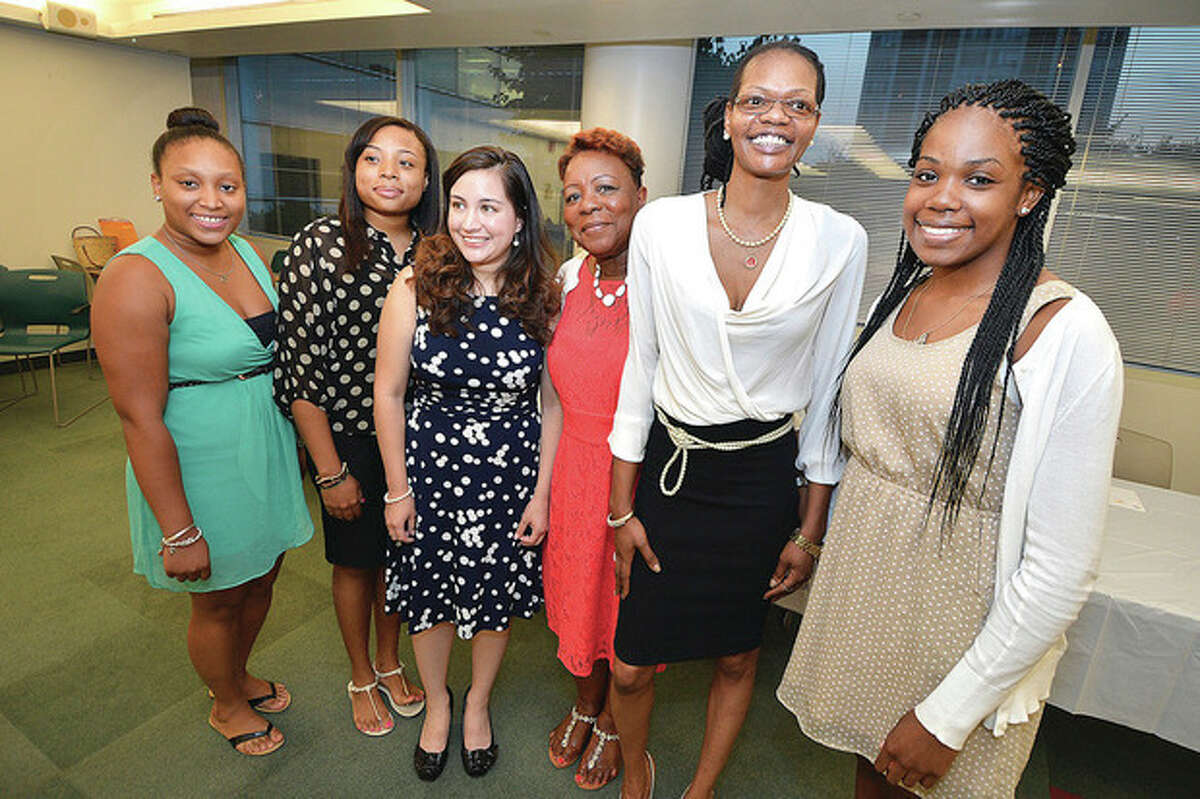 Hour Photo Alex von Kleydorff NAACP Education Chairperson Delores Burgess stands with the scholarship winners l-r Shalimar Azima, Sophonie Cam, Andrea Lopex-Salazar, Patricia Williams and Ashyla Cody.