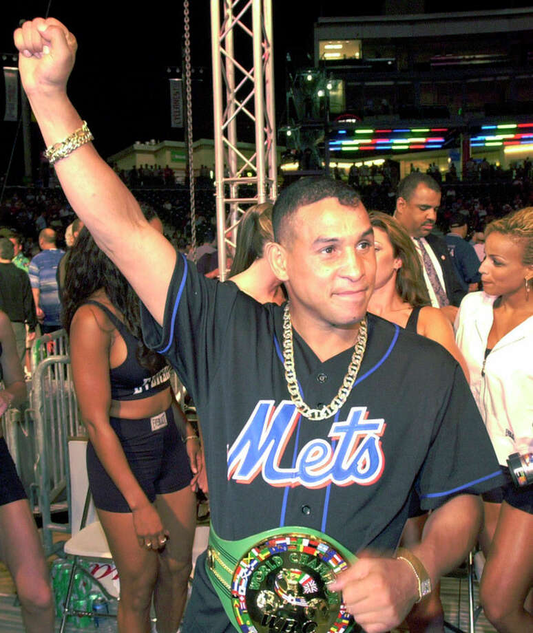 "FILE - In this July 7, 2001 file photo, boxing champ Hector ""Macho"" Camacho acknowledges fans at KeySpan Park in New York's Coney Island. Camacho, a boxer known for skill and flamboyance in the ring, as well as for a messy personal life and run-ins with the police, has died, Saturday, Nov. 24, 2012, after being taken off life support. He was 50. (AP Photo/Stephen Chernin, File) / AP"